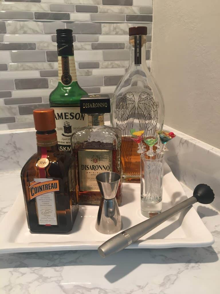 white tray with alcohol bottles