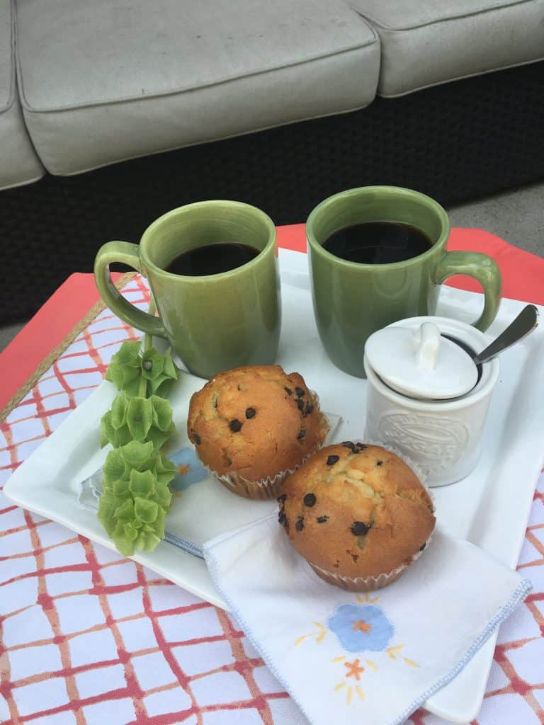 muffins and coffee cups on white platter