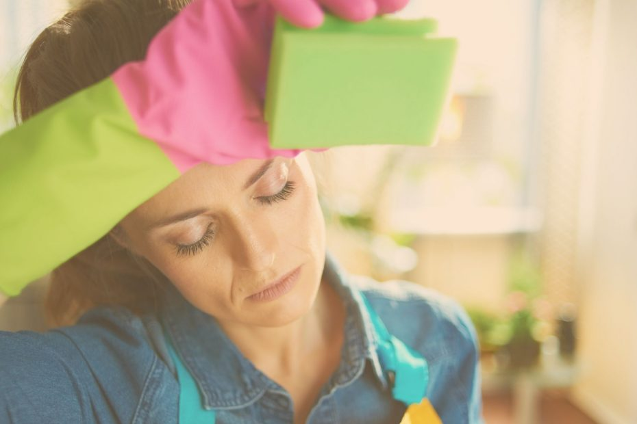 woman overwhelmed by housecleaning