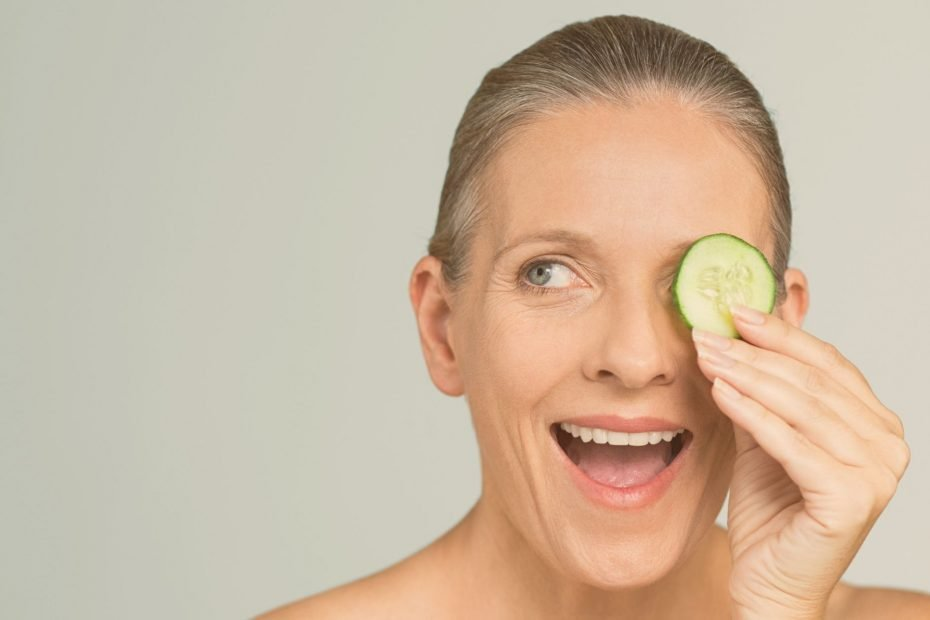 woman with cucumber patch on eye