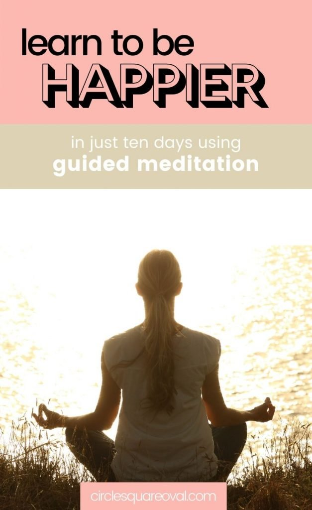can meditation make you happier? rear view of woman in seated meditation overlooking water