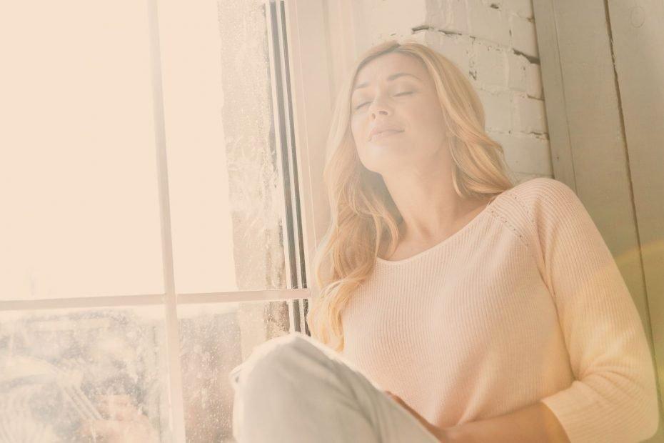 woman relaxing by window