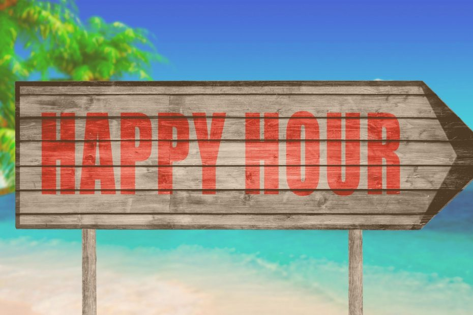 happy hour sign on beach