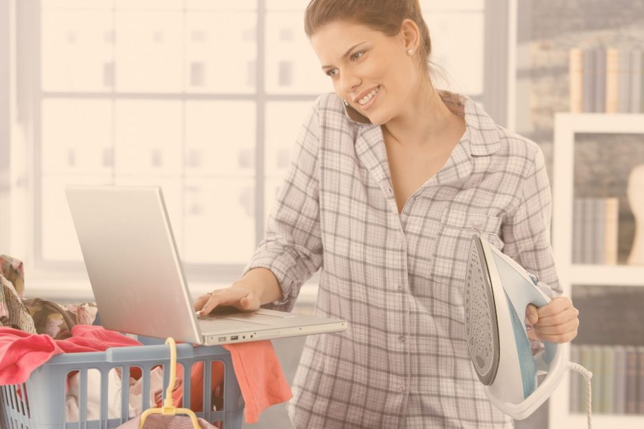 multitasking woman with iron, laundry, and computer