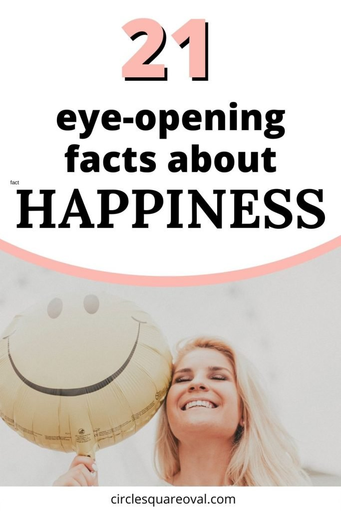 smiling blonde woman holding smiley face balloon, thinking of facts about happiness