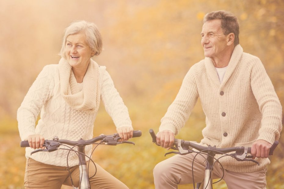 couple laughing while riding bikes