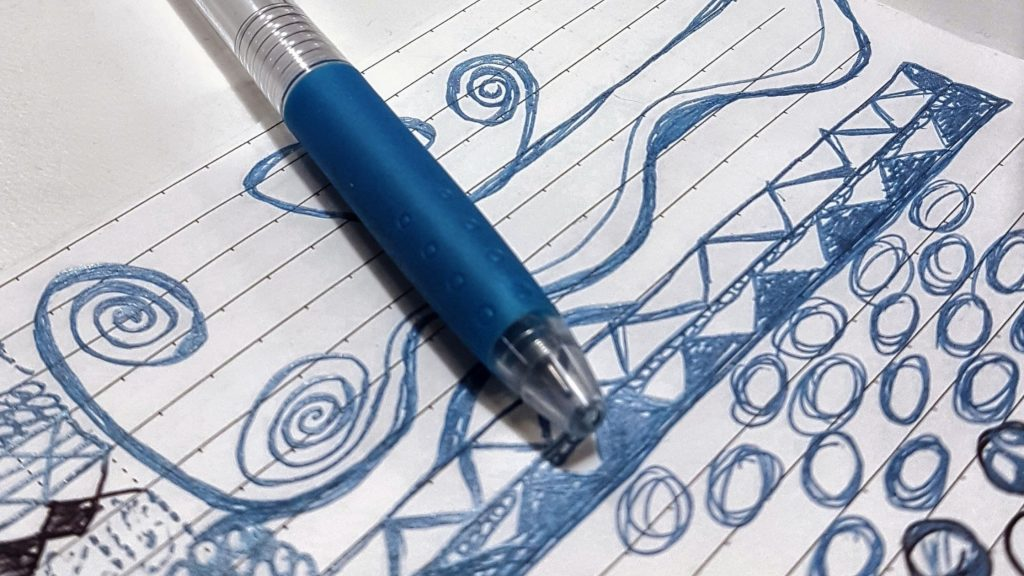 blue pen with blue doodles on lined page, boost your creativity by allowing yourself to be bored