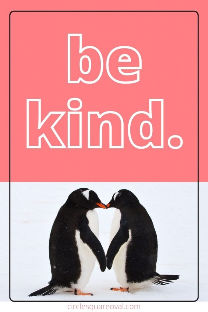 two penguins kissing.  message be kind.
