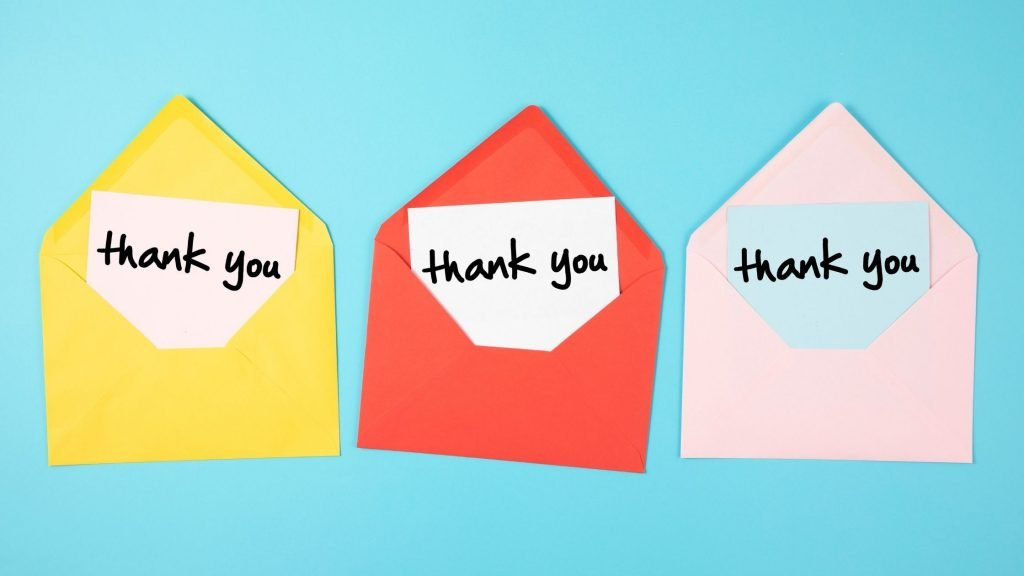 3 bright envelopes each with a thank you note inside, creative ways to say thank you