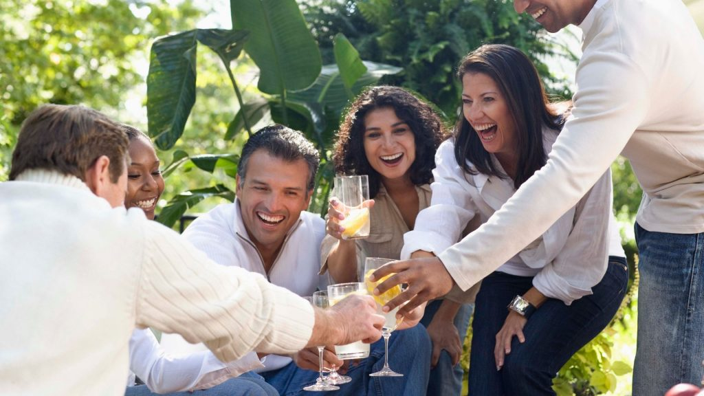 neighbors having a party sharing laughs and cocktails