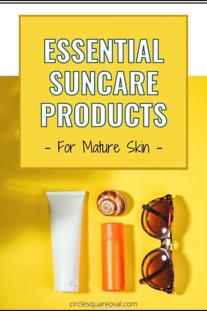sunscreen, lip balm, shell, and sunglasses on a bright yellow background