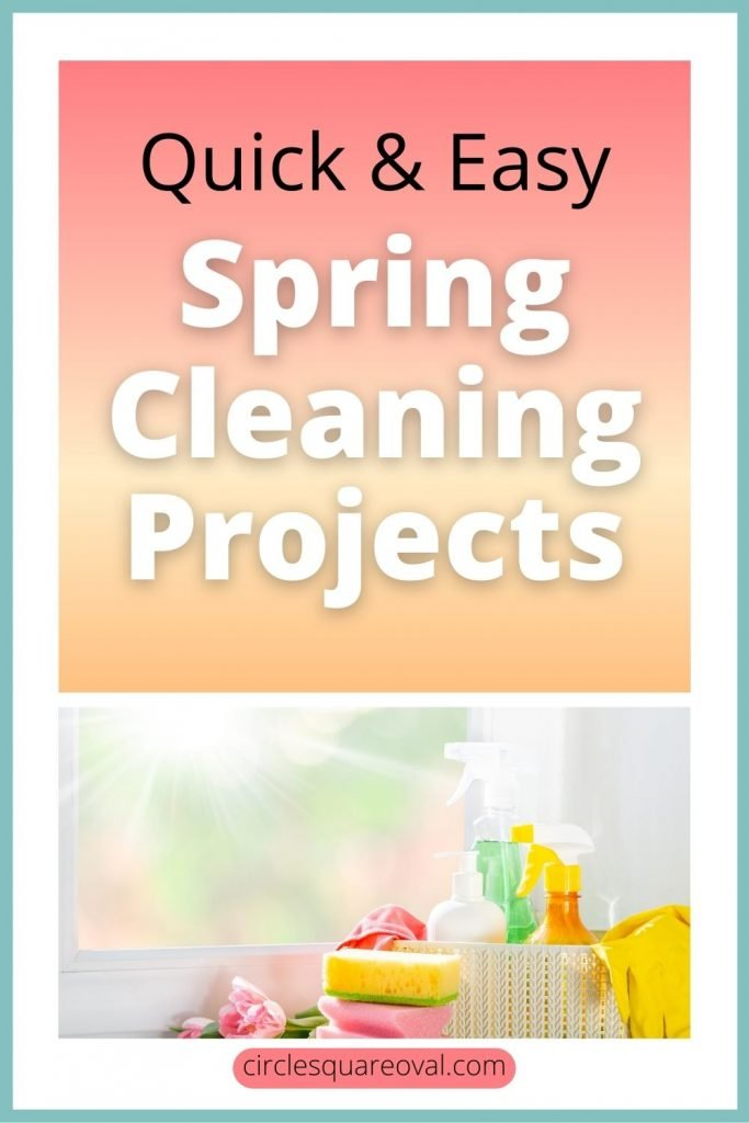 cleaning supplies in bright spring colors by window with sun shining