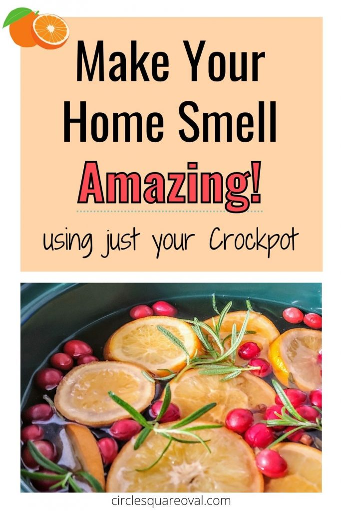 oranges, cranberries, and rosemary in a black crockpot make your home smell amazing using a crockpot