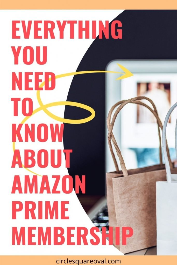 computer on Amazon shopping site, with small shopping bags