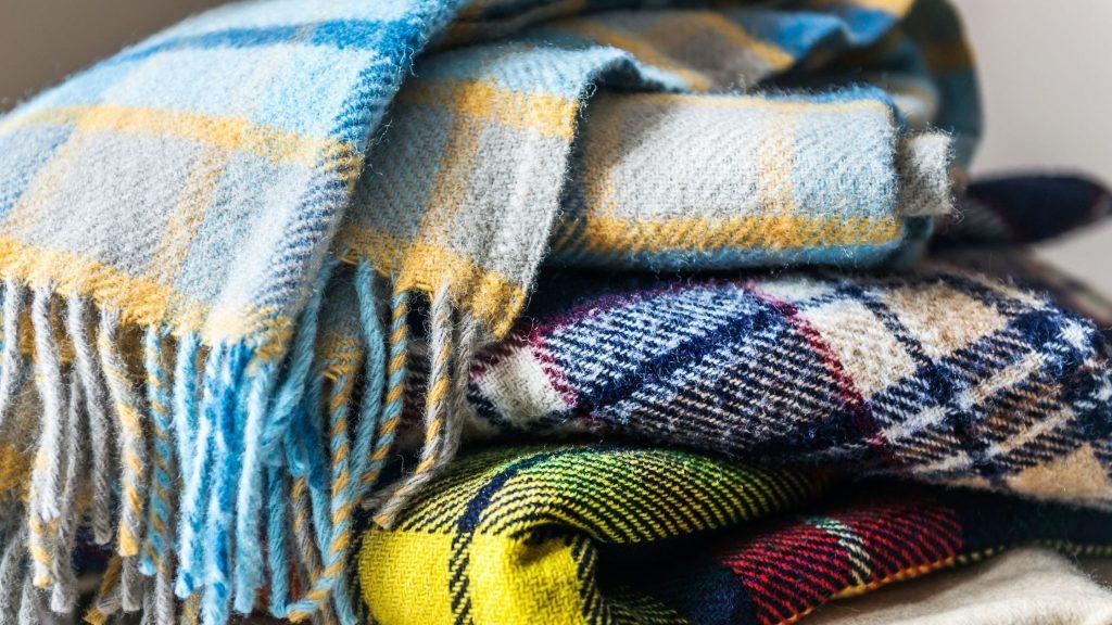 pile of wool plaid blanket