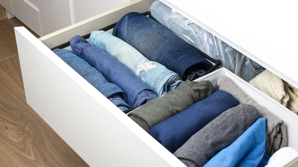 jeans and tops file folded in drawer