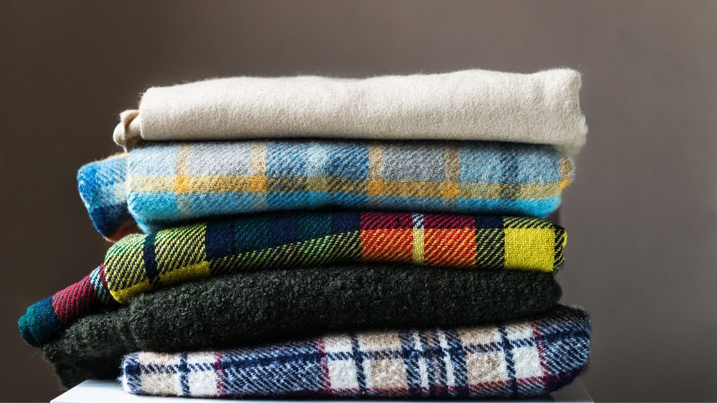 stack of plaid wool blankets