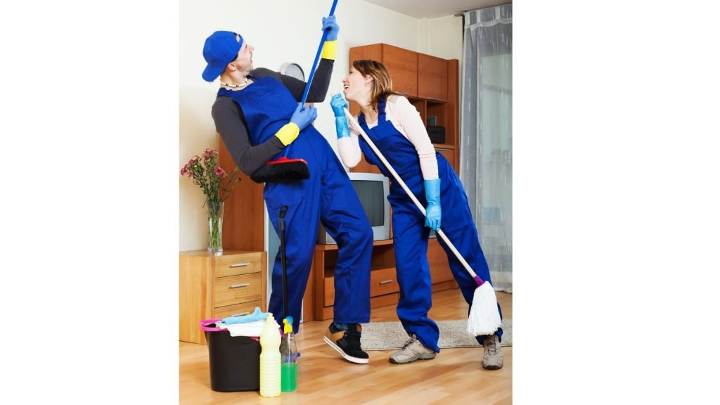 man and woman playing concert rock stars while cleaning house
