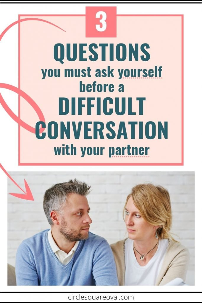 man and woman looking at each other as they have a difficult conversation