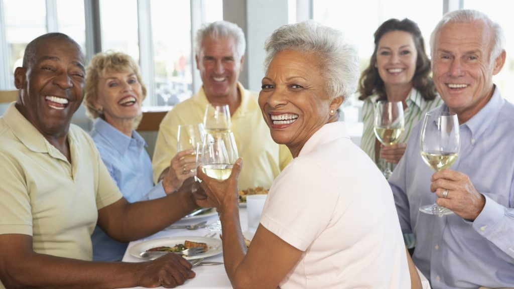 group of friends drinking wine and laughing together, 3 keys to a lasting marriage include friendships