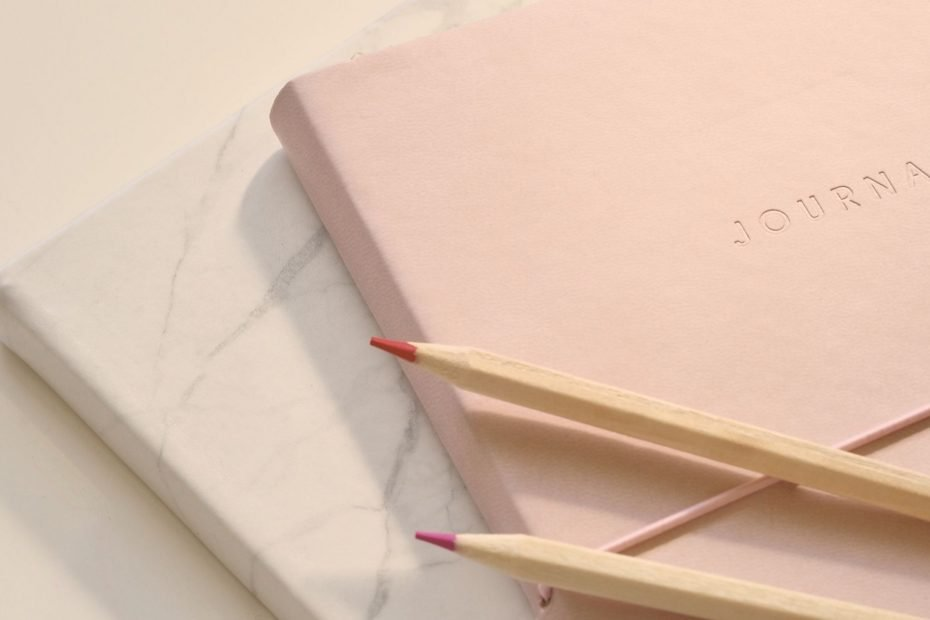 pink journal and pencils