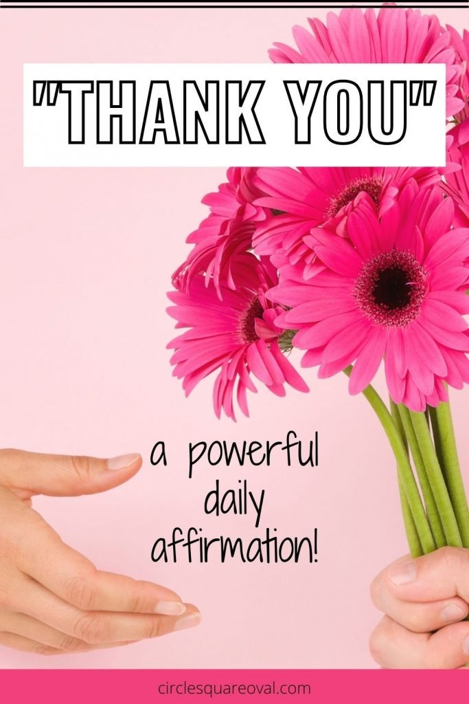hand giving pink daisies to another hand to express thanks to others
