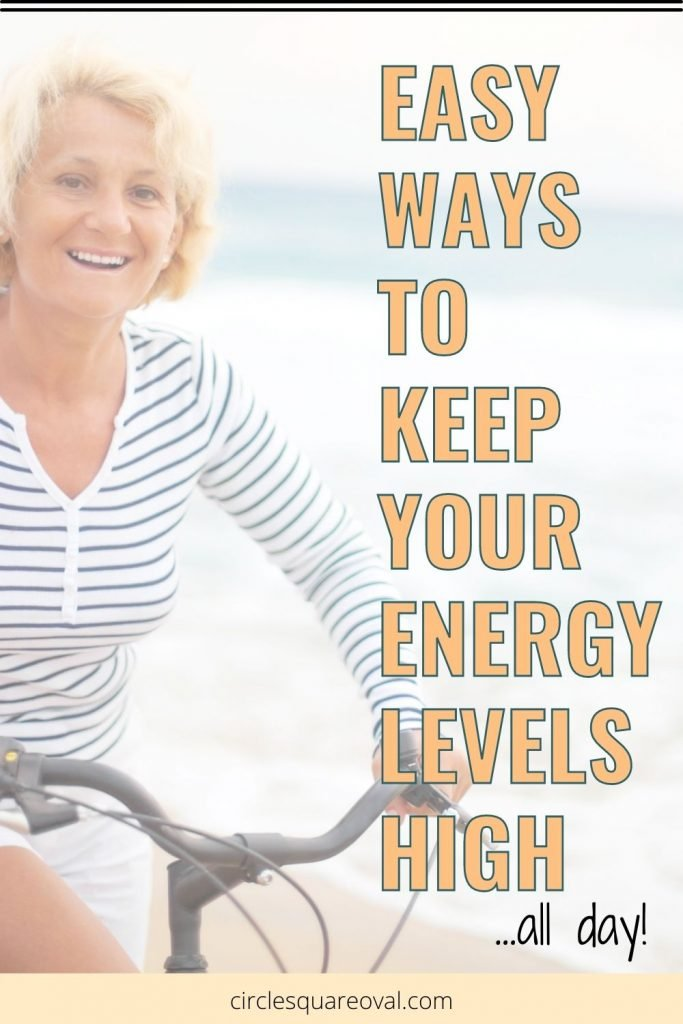smiling woman riding bike on beach, 4 easy ways to keep your energy levels high all day