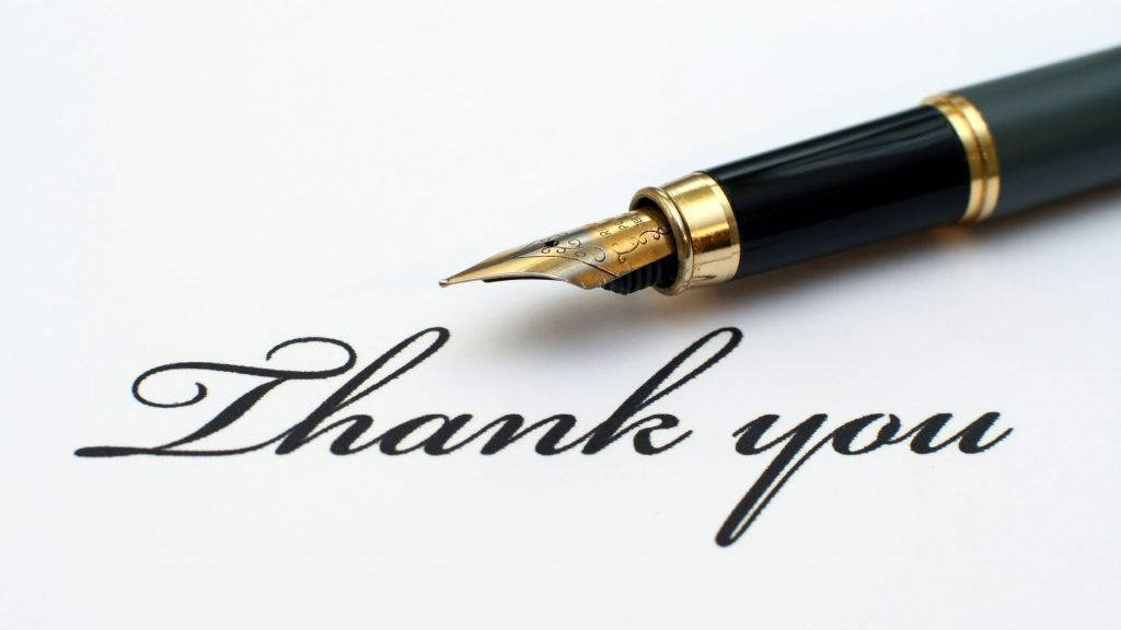 """forma script words """"thank you"""" written on white paper with black fountain pen"""