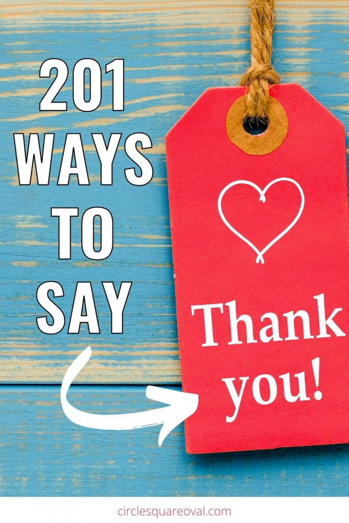 """blue aged wood background with large red tag reading """"thank you"""""""