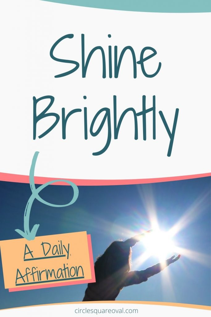 woman who looks like she's holding the bright sun.  Daily affirmation:  I shine brightly.