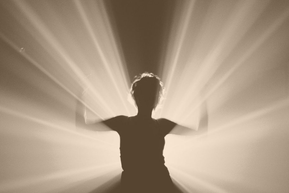 woman with light shining from within